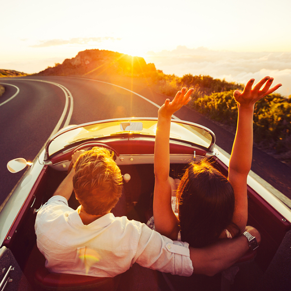 Happy,Couple,Driving,On,Country,Road,Into,The,Sunset,In vintage car