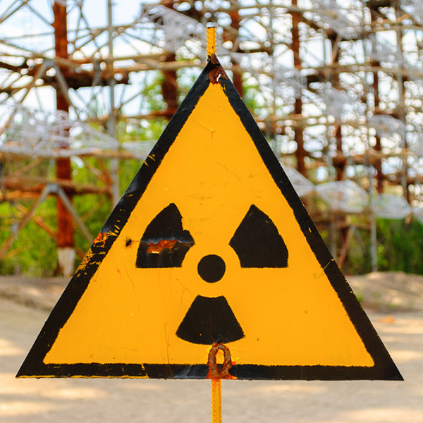 Radiation warning sign in front of Duga, a Soviet over-the-horizon (OTH) radar system as part of the Sovietic anti-ballistic missile early-warning network, Chernobyl